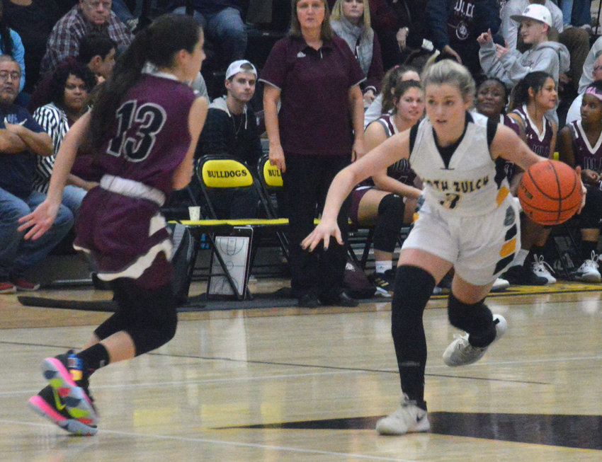 Samantha Moore of North Zulch dribbles by the press during a Lady Bulldogs home game at NZHS.
