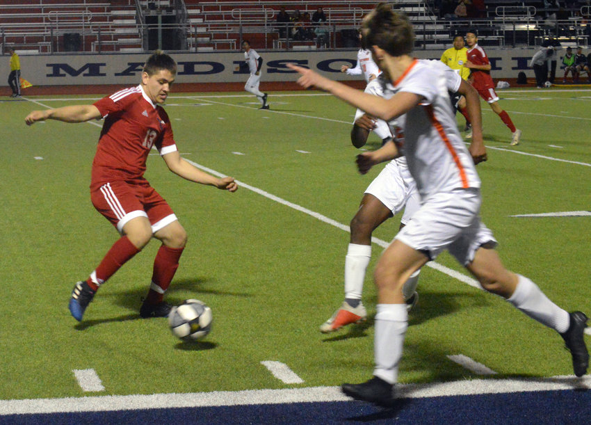 Madisonville's Gabriel Sanchez fights for the ball during a Mustangs home game against Westwood at MHS.