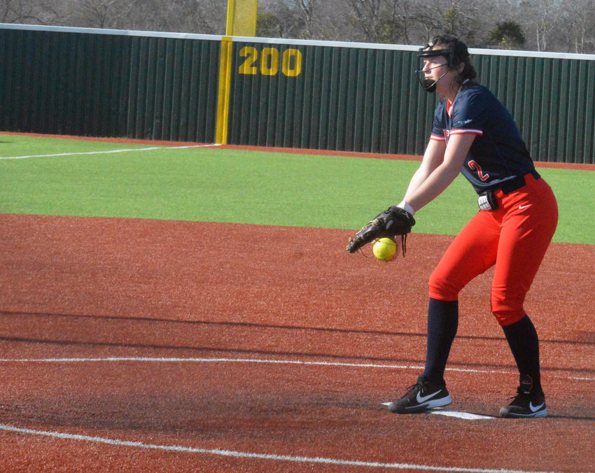 Madisonville's Kyndall Creighton delivers a pitch during a Lady Mustangs home game at MHS.
