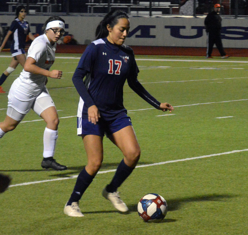 Madisonville's Andrea Hinojosa advances the ball during a Madisonville home game.