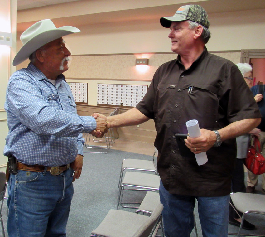 Billy J. Reeves (left) and Bobby Adams shake hands at the Truman Kimbro Center March 3