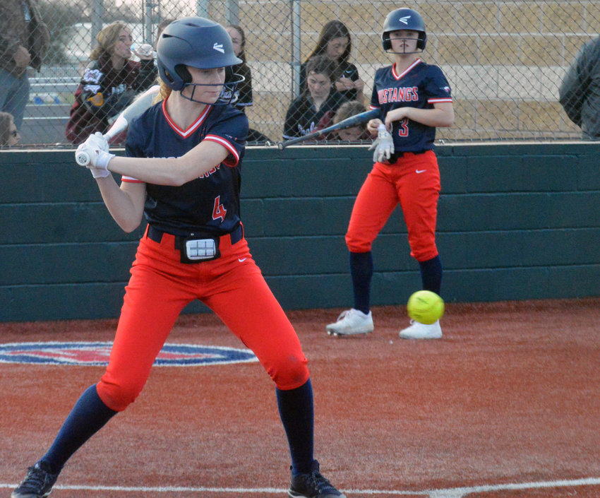 Madisonville's Brinna Sims swings at a pitch during a Lady Mustangs home game at MHS.