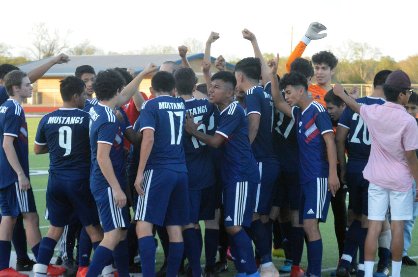 The Madisonville soccer team celebrates following their 5-3 shootout victory over Crockett at MHS March 10.