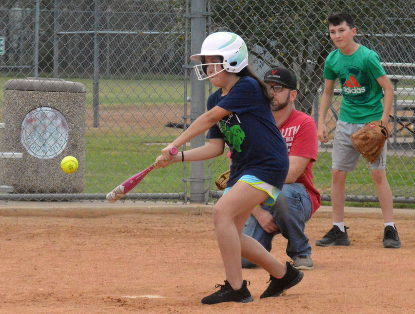 Jocelyn Aldava connects with a pitch during the scrimmage portion of Saturday's softball clinic at Lake Madison Park.