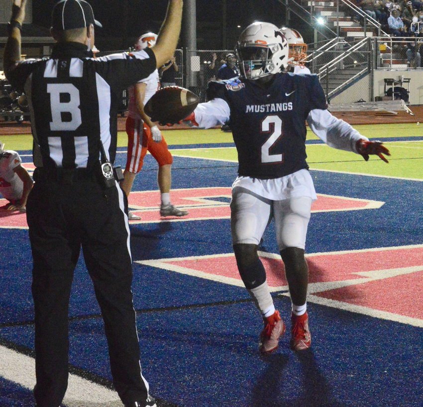 Doug'kyrn Johnson hands the ball to the referee following a 24-yard touchdown reception in the back of the end zone Friday.