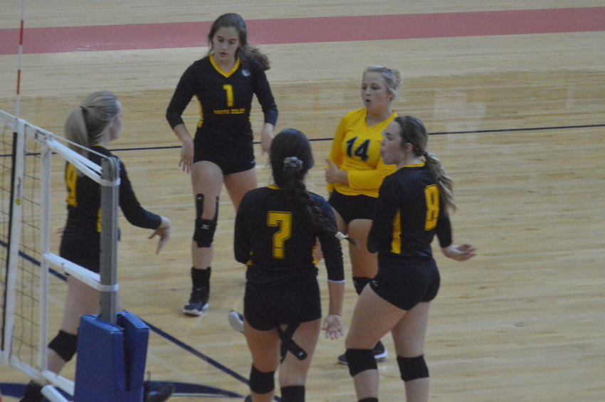The North Zulch volleyball team celebrates a successful point.