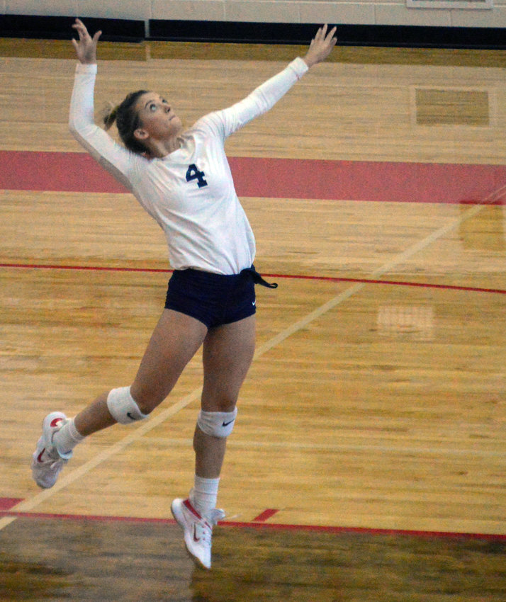 Sidnie Smith executes a jump serve during a Lady Mustangs home matchup at MHS.