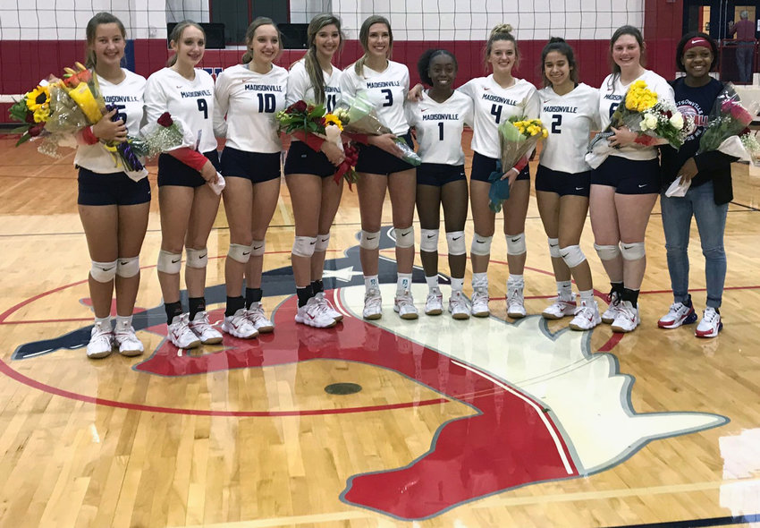 Madisonville volleyball seniors (from left) Brooke McKean, Haley Fleck, Kourtney Fleck, Riley Pitcock, Grace Williamson, Kia Moffett, Sidnie Smith, Raegan Olvera, Taylor Barrett and Daiona Johnson pose together on senior night at MHS Friday.