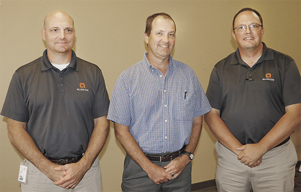 Chad Brawner (left) and Monte Bowers (right) were the featured speakers at McKenzie Rotary Club. Joe Neumair, center, was the program sponsor.