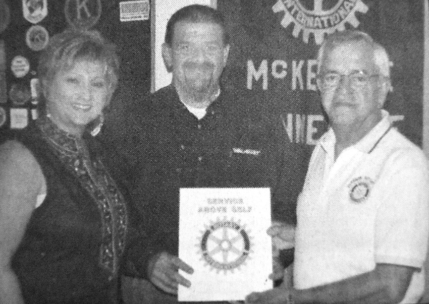 10 YEARS AGO — McKenzie Rotary President Jim Arnold (right) welcomes Dennis Cupples (with wife Renae) as the newest member. Cupples was the manager of Wal-Mart in Huntingdon.
