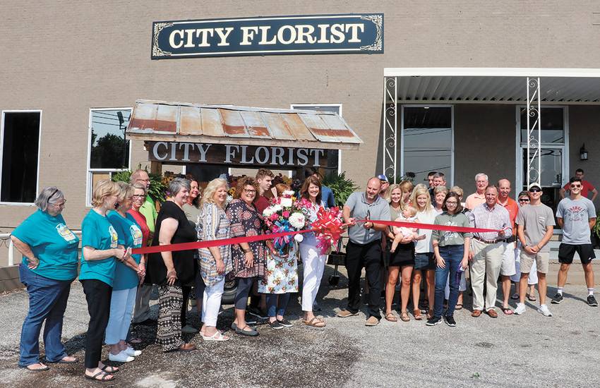 A ribbon-cutting ceremony Saturday marked the grand opening of City Florist and More at its new location.
