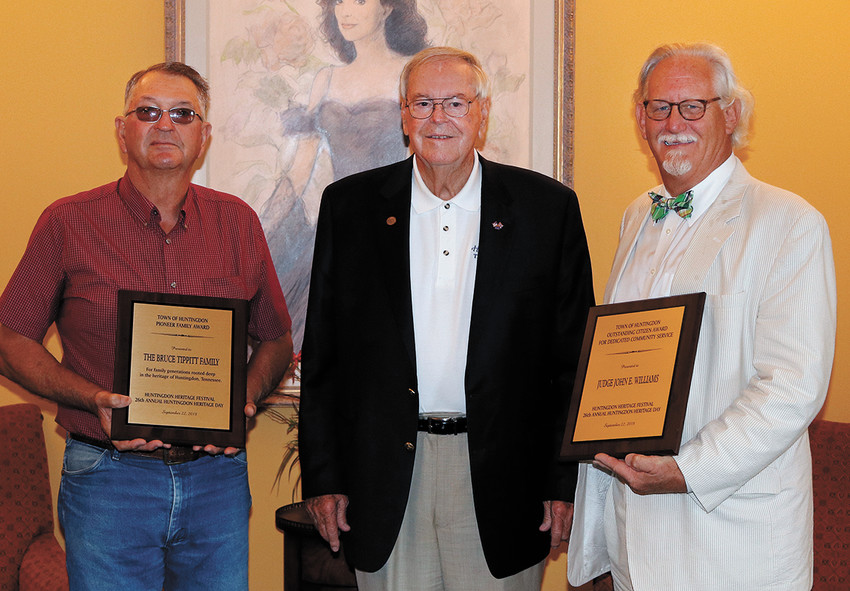 Glenn Tippitt (left) and John Everett Williams (right) were presented plaques to commemorate the day by Mayor Dale Kelley (center)