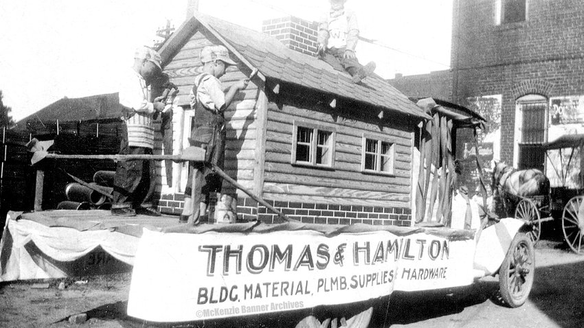 Thomas & Hamilton Hardware Co. Parade Float, 1928. Riding are James Hickerson and Merald and Mildred Thomas.