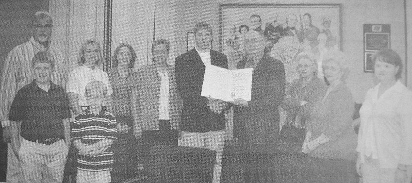 10 YEARS AGO — McKenzie Mayor Walter Winchester presents a proclamation in honor of Tom Nolen to the Nolen family. Nolen's grandson, Kelby McCaleb, accepted the award on his grandfather's behalf.