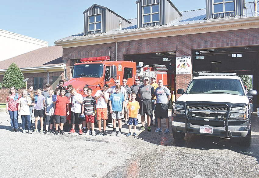 MMS students washed fire trucks, police cars and other emergency vehicles at city hall.