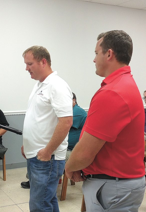 Chad Allen (L) and Drew Watson (R) from Tennessee American Water speak to Trezevant board.