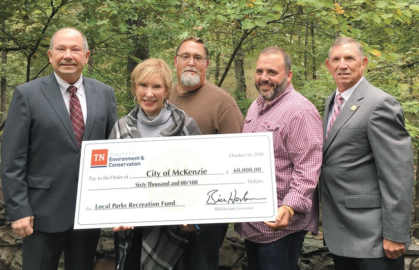 McKenzie Mayor Jill Holland and Parks Director Mike Beasley participated in the check presentation by the State of Tennessee for purchase of new playground equipment at McKenzie City Park.