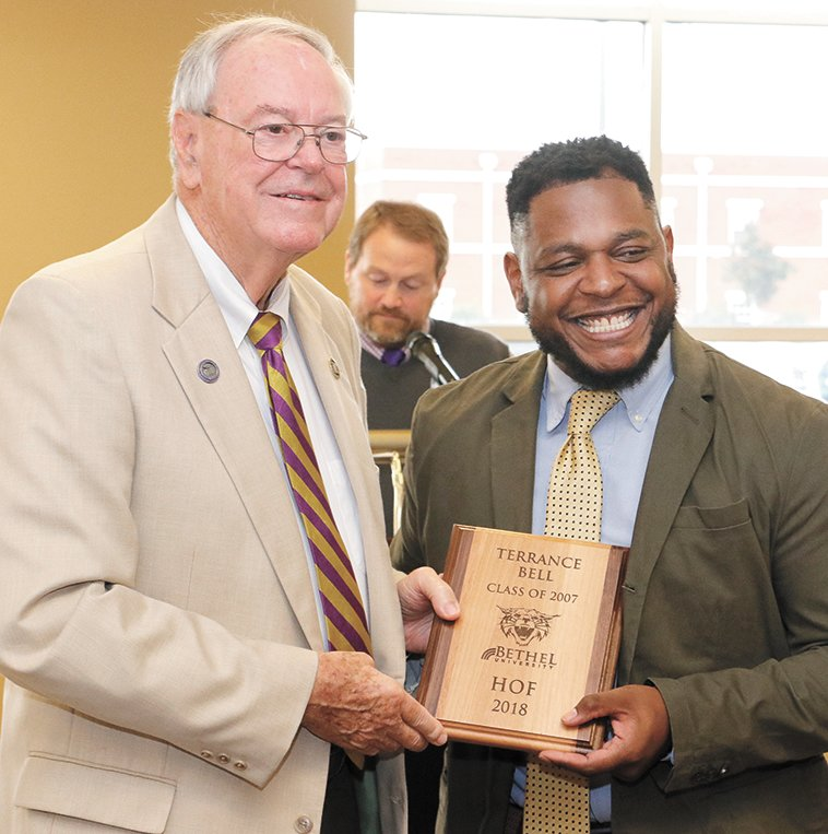 Terrance Bell was honored as an inductee. He is pictured by Dale Kelley, athletic director.