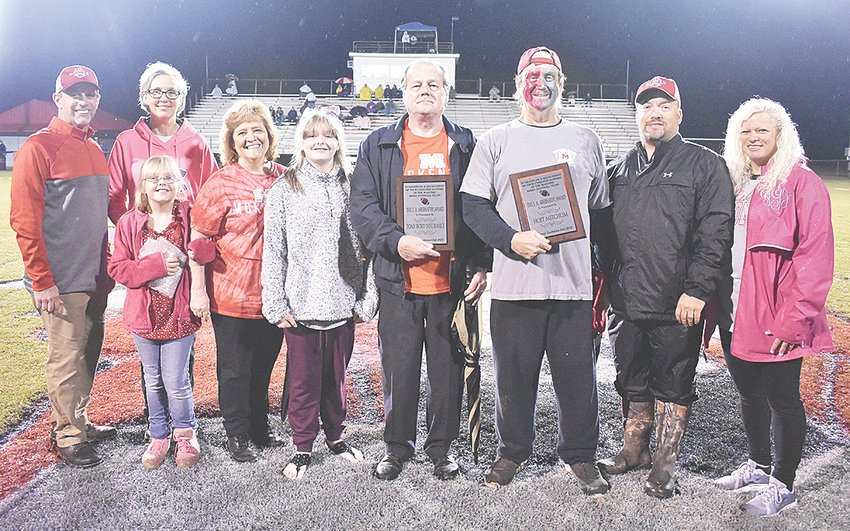 The annual J.A. Abernathy Awards given by the McKenzie Booster Club were given during Senior Night festivities. The Individual Award went to Hoit Mitchum who has only missed 3 games in the last 20 seasons. The Business Award went to Tony Boyd Insurance. Standing L to R: Booster Club President Jay Phipps, Gina King, Rebekah McCarty, Sharon Boyd, June McCarty, Tony Boyd, Hoit Mitchum, Dustie Graves, and Tammy Graves.