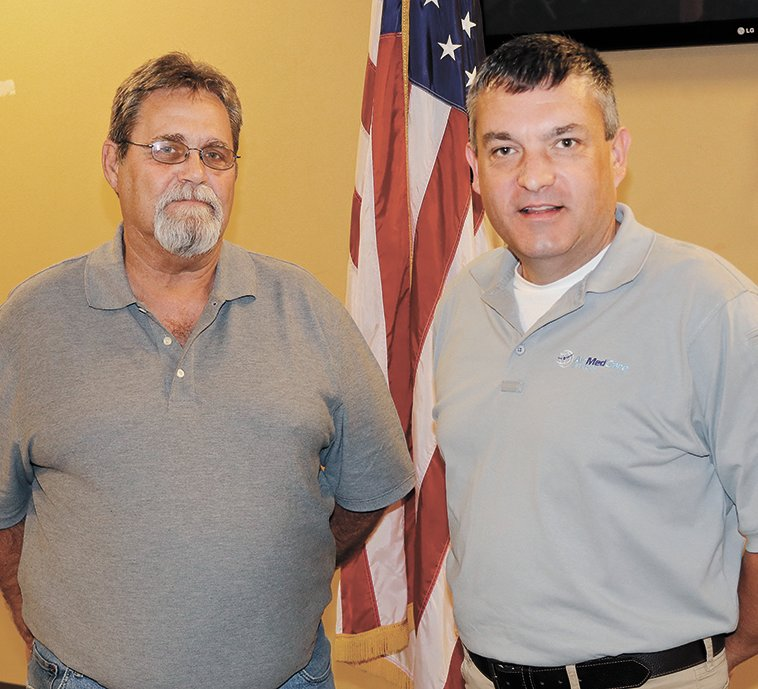 Rotarian Bob Denison and Rick Perry of AirEvac Lifeteam.­