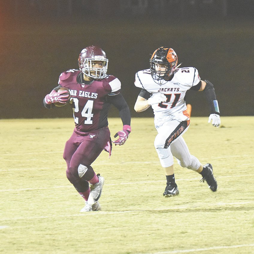 War Eagle Jarrius Weatherford runs past Greenfield defender Grant Huffstetler and turns downfield for a solid gain.