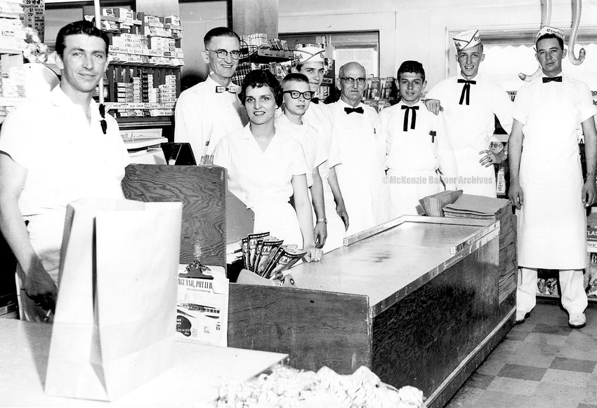 McKenzie's and Carroll County's first supermarket, Jr. & Jerry's, was opened in 1960 by Junior Blackburn and Jerry Hopper. Junior became sole owner in the early 1960s and the name was changed to Junior's J&J. Early 1960s (L to R): Junior Blackburn, Joe Burroughs, Margaret Vinson, Billy Barksdale, Jerry Bomar, Filmore Barker, Joe Gooch II, Brice Page, and Jerry Hopper.