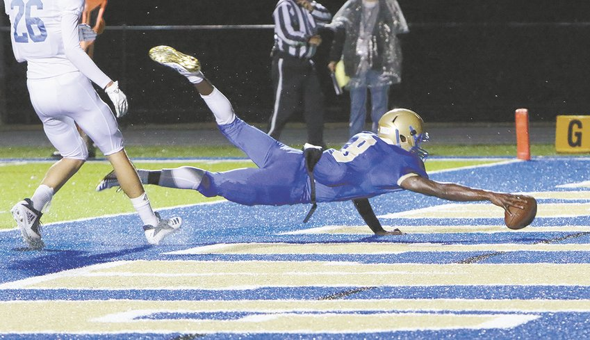 Dallas Willis dives for one of his two touchdowns for Huntingdon.