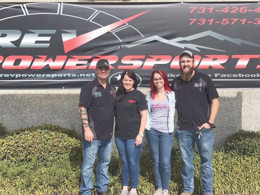 Cutline: (L to R) Business partner Dwain Carter with wife Jennifer; Bridget and Collin Johnson. Photo courtesy Collin Johnson
