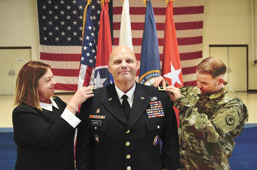 Maj. Gen. Tommy Baker is pinned with his new rank by his wife Camille and his son, 1st Lieut. Cody Baker, during his promotion Ceremony at the Tennessee National Guard headquarters on November 9, 2018. (U.S. Army photograph by Sgt. 1st Class Edgar Castro)