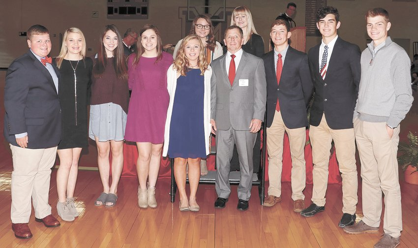 Student participants in the annual Veterans Day program. (L to R) Drew Beeler, Emily Bolin, Sydney Pate, Macey Ognibene, Julie French, Norman French (speaker), Will McBride, Lane Horton, and Eli Surber, (back L to R) Jenna Tucker and Kennedy Green.