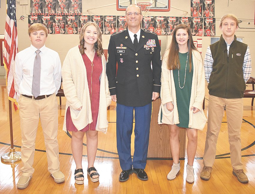 Speakers at the MMS Veterans Day program were (L to R): Nolan Renfro, Kristin Bradberry, guest speaker Sergeant Major Spiros Roditis, Lilly Sumrok and Jackson Cassidy.