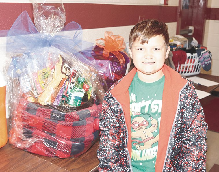 Rylan Forrest of Atwood inspects the items on the silent auction.