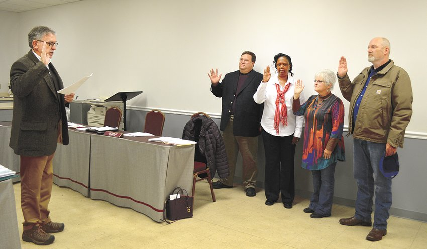 Board members Eddie Granger, Pam Joyner, Teresa Goodrum, and Joe Fowler take the oath of office.