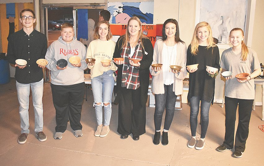 Amber Gilmer, NWTEDC county service manager for Carroll County, and the McKenzie High School Beta Club Service Team display bowls at the soup supper. Pictured (L to R): Nathan Rorer (service team spokesperson), Drew Beeler, Lauren Mansfield, Gilmer, Olivia Wright (service team leader), Allie Chappell and Ashlyn Drewry.