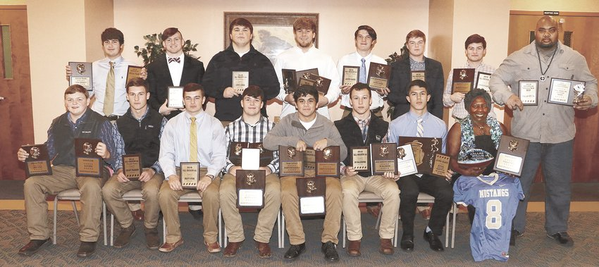 Football Awards – (front L to R) Kody Byrd, Kelby Pearson, Brett Huss, Austin Avery, Joseph Richardson, Bo McLemore, Hunter Ensley, and Tyronza and Tracy Beene – representing their son, Dallas Willis, who was participating in an all-star game, (back L to R) Cole Edwards, Matthew Ellis, Reed  Jones, Chris Chaney, Austin Baker, Drake Butler, and Konnor Pearson.