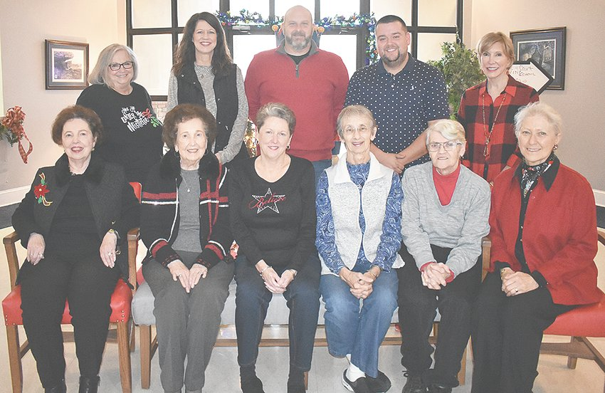 The Morning Glory Garden Club presented its annual Best Decorated Business Window award, with a $50 prize, to McKenzie City Florist & More. The City of McKenzie presented its Best Novelty Decoration award, with a $100 prize, to Mason and Lauren Powers. Pictured are (L to R): Front Row — Morning Glory members Kay Wilson, Robbie Barker, Sally Sutton, Recording Secretary Zia Locke, Photographer Julia Winters and Vice President Judy Davis; Back Row — City Recorder Jennifer Waldrup, City Florist owners Michele and David Jarrett, Mason Powers and Mayor Jill Holland.