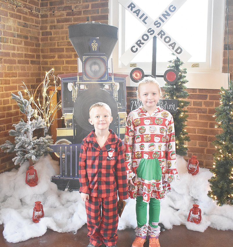 Jackson (5) and Savannah (8) Vinson of Huntingdon wait at the depot to board the Polar Express during McKenzie's A Mistletoe Christmas.