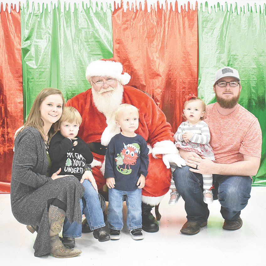 The Wrights, Mason (2) with mom Tanya and Elsie (1) with dad Justin, all of Jackson, and cousin Ethan Anderson (2, center) of Cedar Grove visit Santa at West Carroll's Breakfast with Santa.