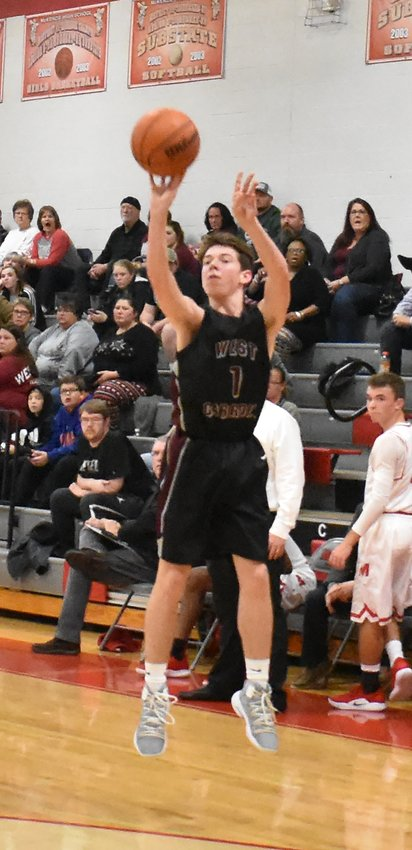 War Eagle Luke Moore fires a three. Moore led West Carroll with 22 points in the overtime win.