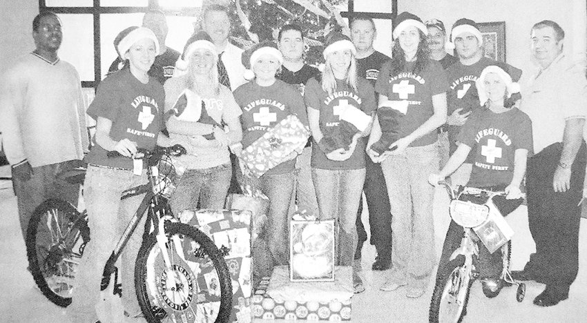 """10 YEARS AGO — DARE sponsored a """"Christmas for Kids"""" event in which area citizens and businesses helped provide a merrier Christmas for 36 families in need. Pictured are (L to R): Front Row — DARE role models Abby Carlton, Linley McClain, Lacey Lane, Josie Carlton, Amber Nunnery, Jacob Fussell and Allison Owen; Back Row — McKenzie councilperson Shaun Thompson, Assistant Fire Chief Roger Christian, Officer Tim Nanney, Officer Ryan White, Fire Chief Brian Tucker, firefighter Jamie Boyd and DARE Officer Jackie Sykes. Also, McKenzie football standouts Jacob Fussell and John Johnson were selected First Team All-State by the Tennessee Sports Writers Association."""