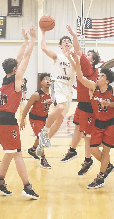 War Eagle Luke Moore pulls up in the paint between four defenders for two points. Moore scored 13 in West Carroll's win.