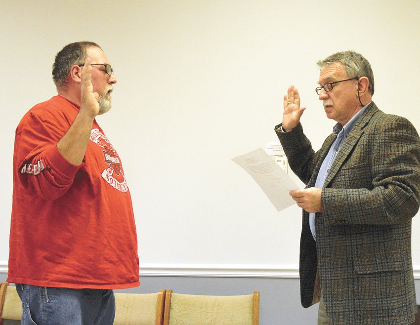 Tim Rogers is sworn in by Charles Trotter to fill the unexpired term of alderman Joe Fowler.