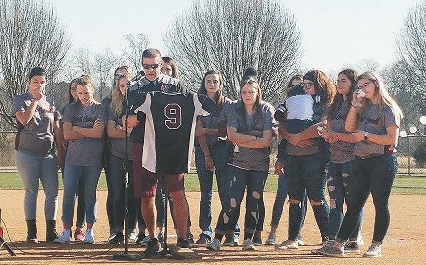 Paul Acuff, West Carroll Softball Coach, eulogizing Ashley with the Lady War Eagle softball team behind him.