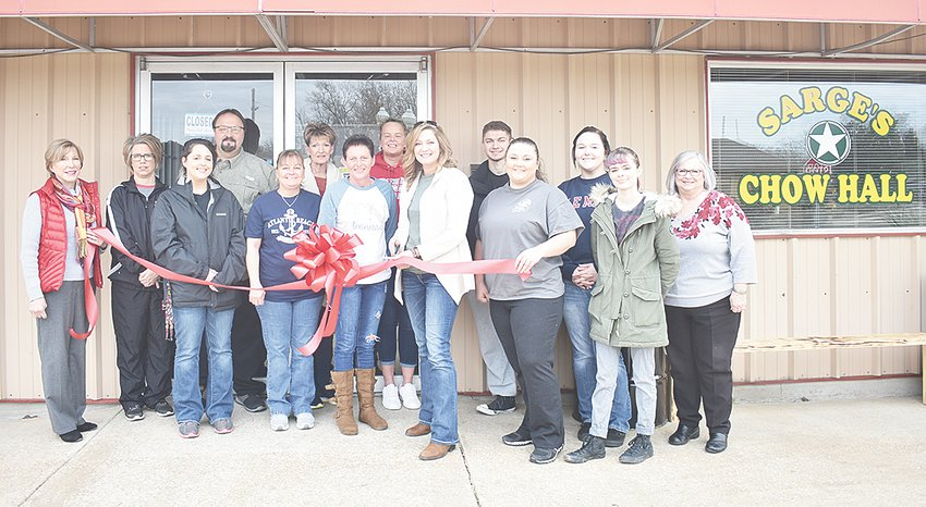 A ribbon-cutting ceremony was held Saturday morning at Sarge's Chow Hall on Waldren Street in McKenzie. Owner Rebecca Sargent-Dyal cuts the ribbon, surrounded by friends, family and business and community leaders, including Mayor Jill Holland.