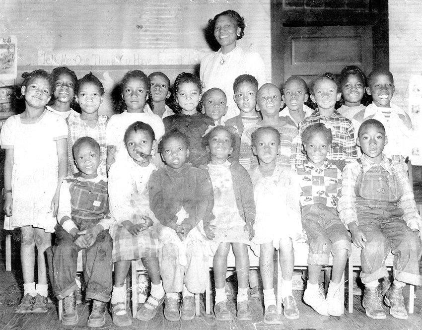 The Mrs. Eva Seets first grade class at Webb School in the late 1940s or early 1950s. Front row far right: John Nolen.