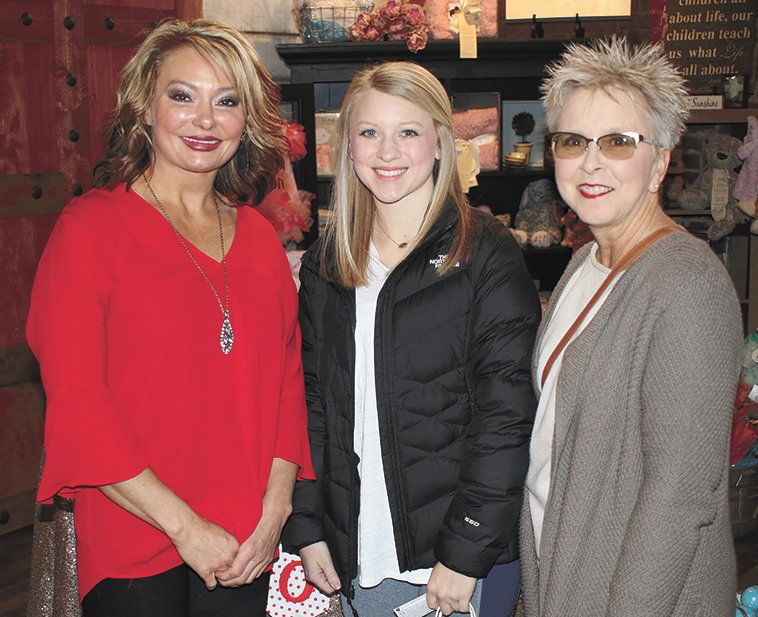 Tessa O'Brien serves chocolate to Natalie McCaleb and Sandra Collins at  Belles on Broadway.