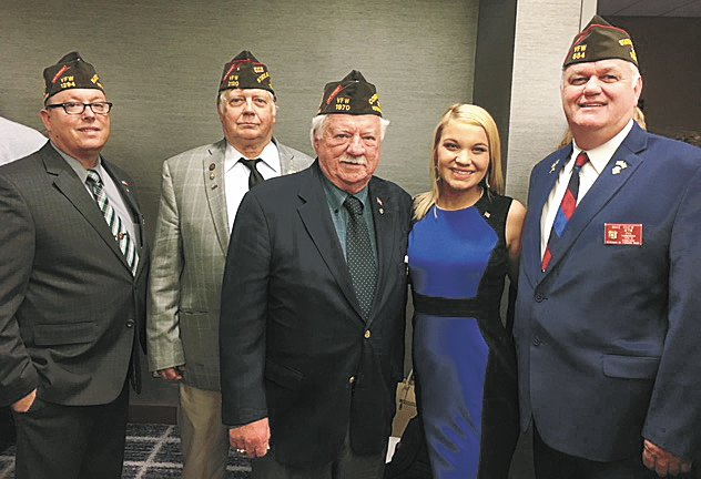 Pictured (L to R) Eddie Bray - National VFW Legislative Committee Member and Henderson County Mayor, Richard Lee - Tennessee Jr. Vice Commander, John Furgess - VFW Past National Commander, Emily and Mike Rhew - Tenn. State Commander. This photo was taken after the parade of winners where the state winners gathered for photos from representatives from their state.
