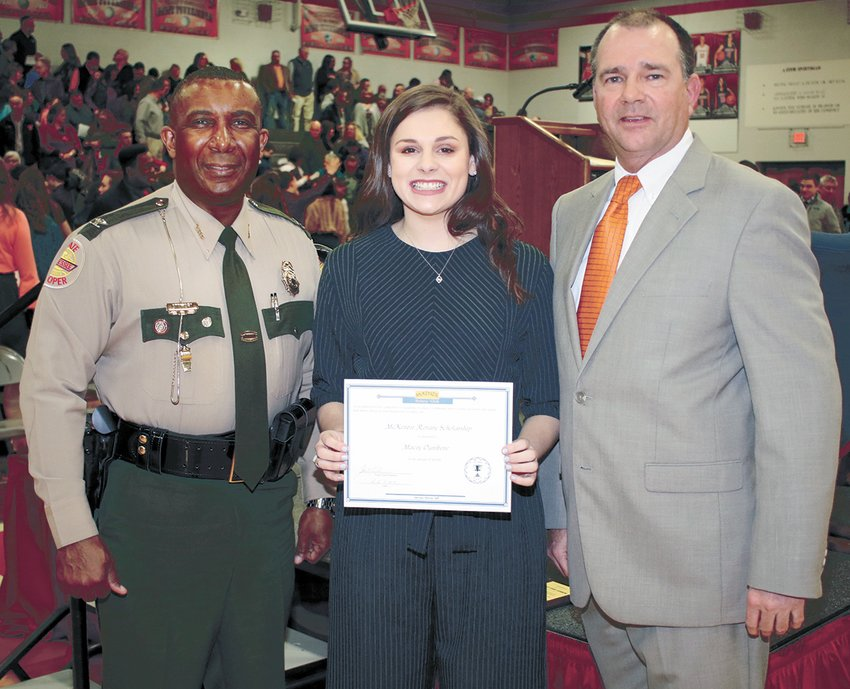 Macy Ognibene was the winner of the $1,000 McKenzie Rotary Club college scholarship. She is pictured with the featured speaker, Colonel Dereck Stewart, a 1983 MHS Alumnus, and Lynn Watkins, the director of schools and McKenzie Rotary Club past president.