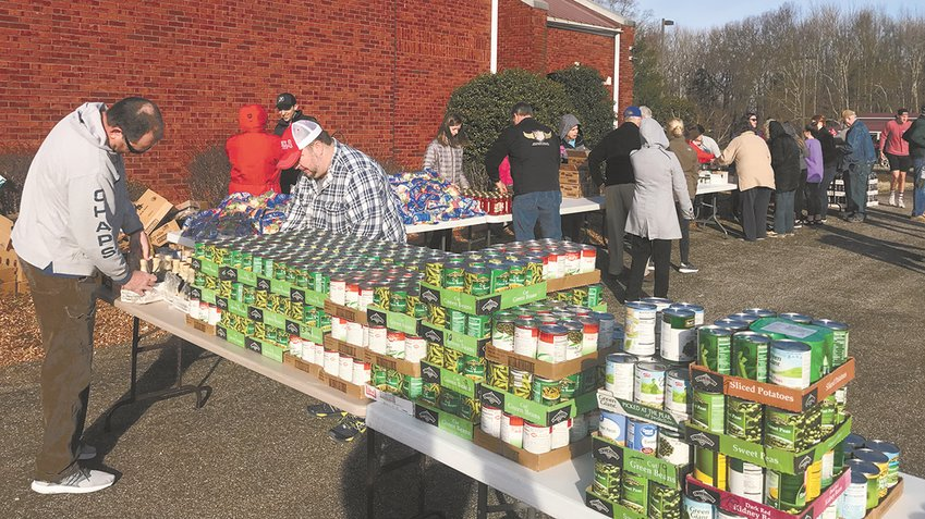 Tables were filled with food for distribution. Members of the CP Church, Rotary Club, Bethel Community Engagement, MHS students, and other volunteers assisted.