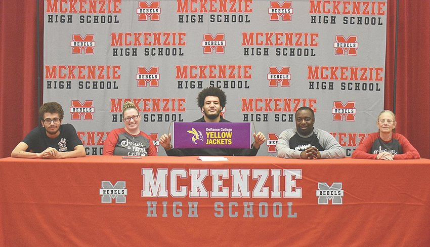 Rebel senior Stephone Haynes signs with Defiance College football, joined by family members. Pictured are (L to R): brother Taylor Haynes, mother Becky King, Stephone, stepdad Matthew King and grandmother Nancy Watson.